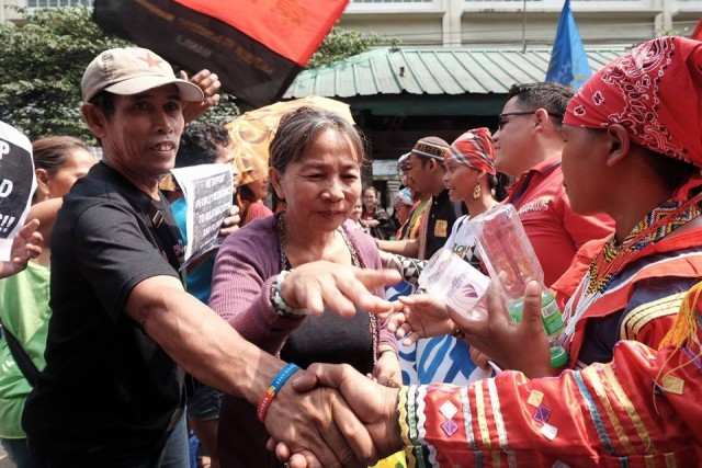 Urban poor leaders welcome the Manilakbayan at Taft Avenue (Photo courtesy of Manila Today)