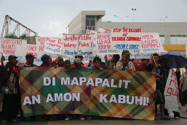 OUR LIVES ARE NOT REPLACEABLE.  Typhoon Yolanda (Haiyan) survivors marched in their thousands to decry the various continuing injustice wrought upon their communities. (Photo from People Surge facebook page)