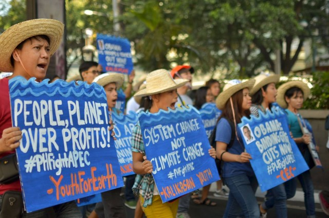 Environmental activists call for a systemic shift to address the climate crisis during the People's Caravan against APEC and Imperialist Globalization. (Photo by Loi Manalansan/Bulatlat.com)