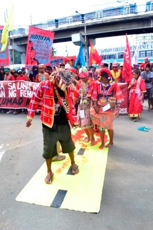 "BLOOD-STAINED PATH. Lumad protesters depict how the Liberal Party's ""tuwid na daan"" is smeared with the blood of   its indigenous peoples defending their ancestral lands. (Photo by Manilakbayan)"