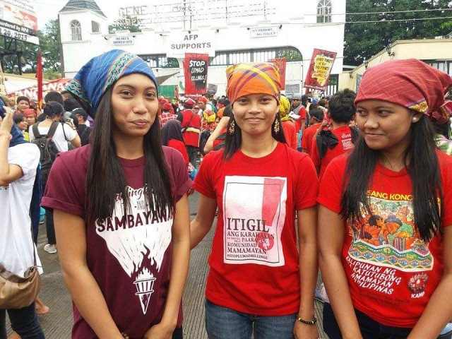 (FILE PHOTO) BLOOMING IN ADVERSITY. Danah Marie Marcellana (on the right), with sister Ara (left) and Lumad activist Michelle Camposin a protest in front of Camp Aguinaldo in 2015 (Contributed photo/Bulatlat.com)