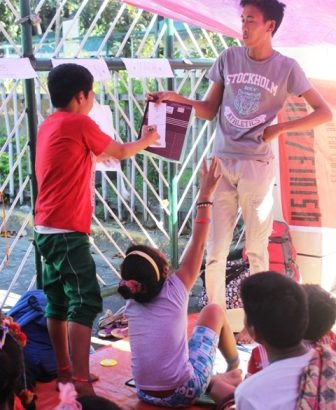 Lumad school children, teachers hold mobile school outside DepEd office