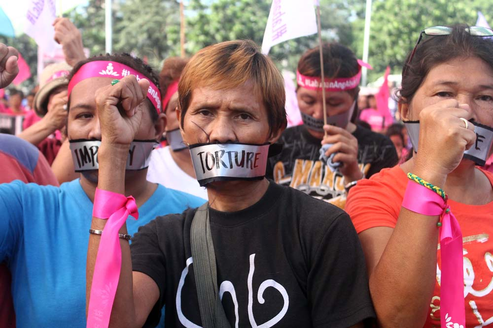Women in duct tapes signify the silencing effect of  violence against women and children. (Photo by A. Umil/ Bulatlat.com)
