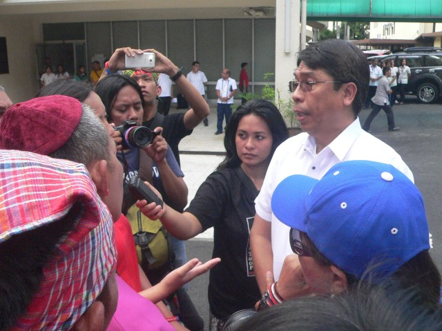 MGB Director Leo Jasareno (right, in white) talks to the protesters. (Photo by D.Ayroso/Bulatlat.com)