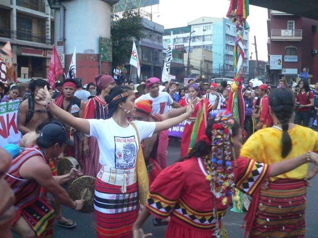 UNITY DANCE. Lumad and Igorots move to the beat of the gongs in a community dance. (Photo by D,Ayroso/Bulatlat.com)