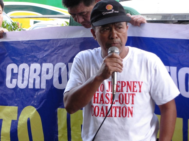 Anselmo Perweg, spokesperson of  No to Jeepney Phaseout Coalition, speaks in front of DOTC offices Dec 2015 (Photo by M. Salamat)