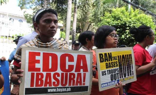FILE PHOTO. Protesters appeal to the Supreme Court to scrap Edca in a picket in 2015. (Photo by Divine Miranda/Kodao Productions)