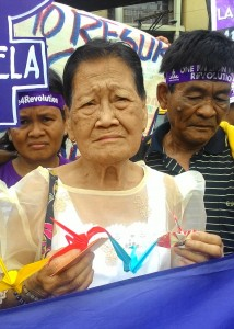 Estelita Dy, 85 also joined yesterday's protest. (Photo by A. Umil/ Bulatlat)