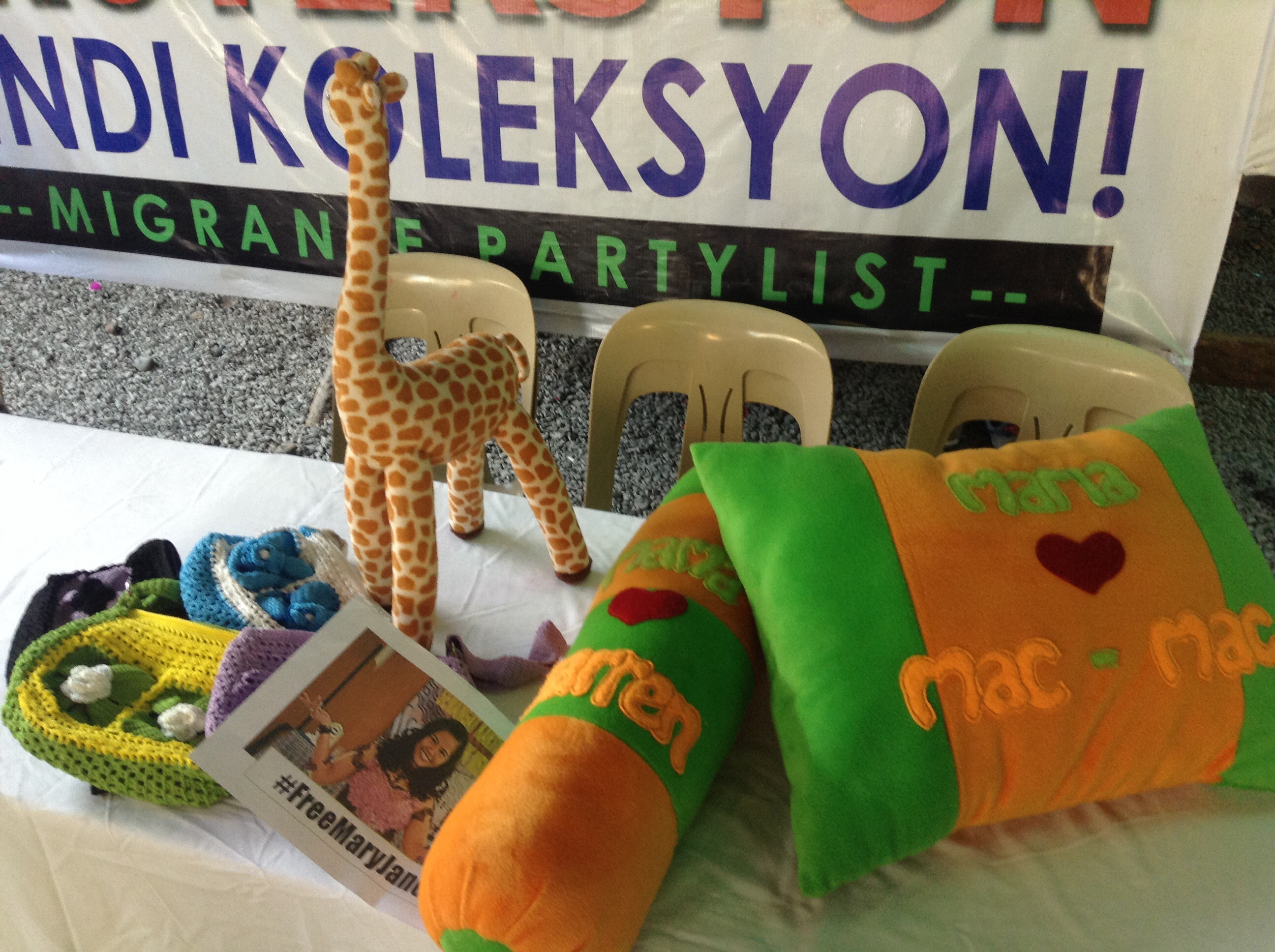 Pillows, crocheted bags and a stuffed toy made by Mary Jane. (Photo by J. Ellao / Bulatlat.com)