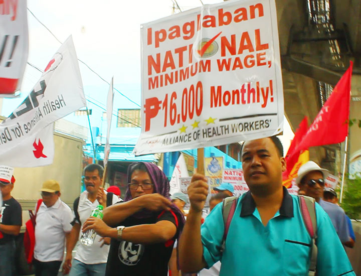 BULATLAT FILE PHOTO. Judyn Bonn Suerte who is among those who receive the lowest salary  joins the protest against the proposed Salary Standardization Law 4. (Photo by Ronalyn V. Olea / Bulatlat)