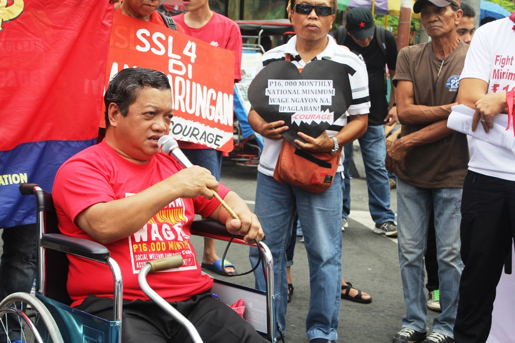 Allan Balaba, 46, an employee of the Department of Social Work and Development for 28 years speaks during the protest on Feb. 16. (Photo by A. Umil/ Bulatlat.com)
