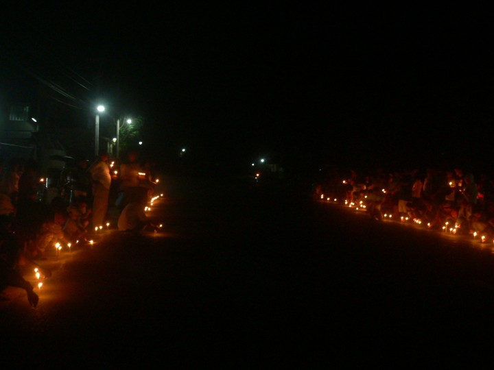 Bayto residents on the road in a prayer and candle-lighting activity with church, peasant and environmentalist groups. (Photo by D.Ayroso/Bulatlat)