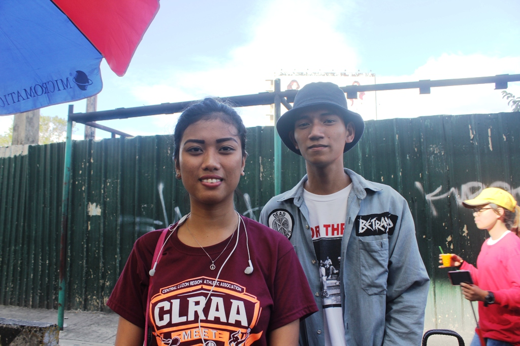 Lorena Dela Cruz, 17 (left) and Kristian Advincula, 19 (right) are both students vow to continue the struggle for genuine freedom. (Photo by Anne Marxze D. Umil/ Bulatlat)