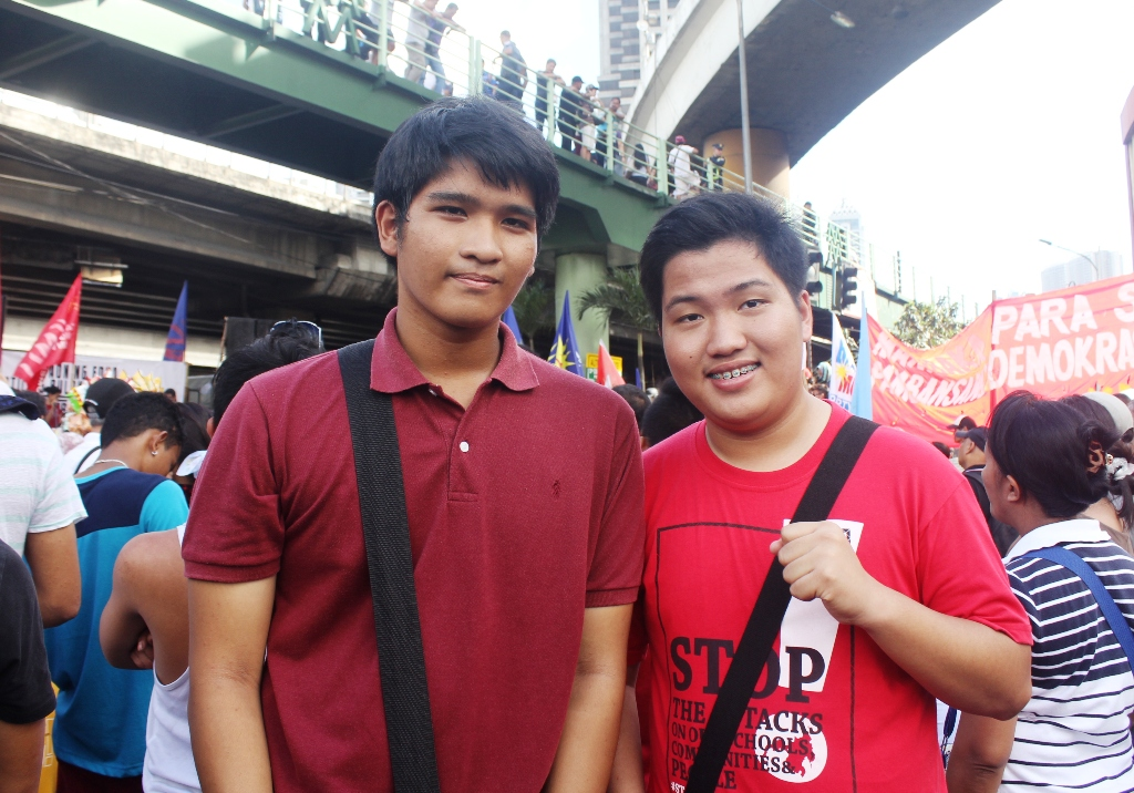 Mark Santos, 15 (left), and his friend Lorenz  Martin Godoy, 17 (right), both from Cavite  in the  30th commemoration of the 1986 people power uprising.  (Photo by Anne Marxze D. Umil/ Bulatlat)
