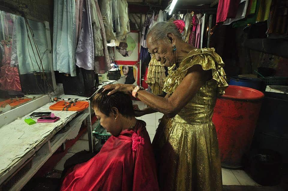 Despite his old age, Lola Dory who is turning a hundred years old this March is still providing service to his customers, such as 'gupit, kulay, kulot', which cost P50-P150 only. During his prime years, he had more than three branches of his own parlor.