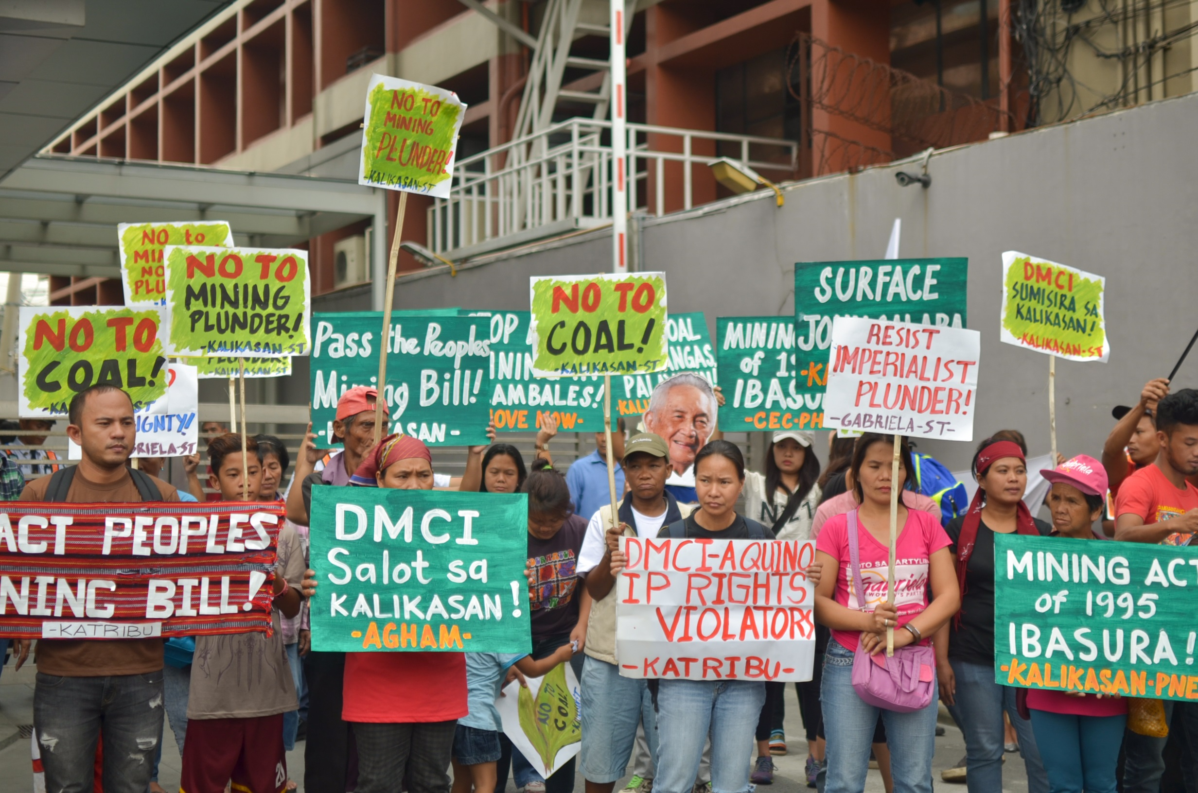Members of environmentalists and mining-affected communities from Mindanao and Luzon joined the protest at the DMCI office in Makati City on March 3. (Photo by Carlo Manalansan/Bulatlat)