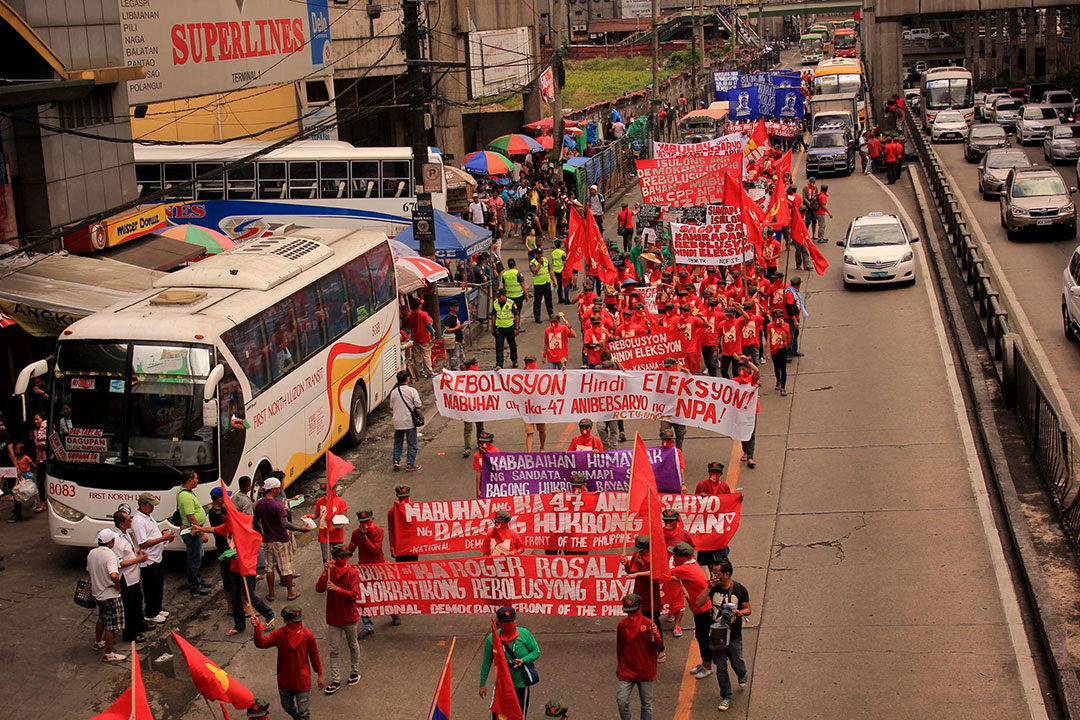 "Thousands march from Cubao, Quezon City to University of the Philippines in Diliman in a public tribute to Gregorio ""Ka Roger"" Rosal, the late spokesperson of the Communist Party of the Philippines. (Photo by Southern Tagalog Exposure)"
