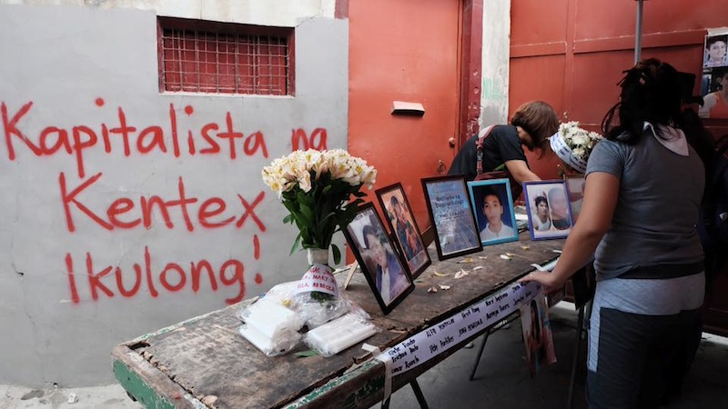 Picture: Mourners for Kentex fire victims
