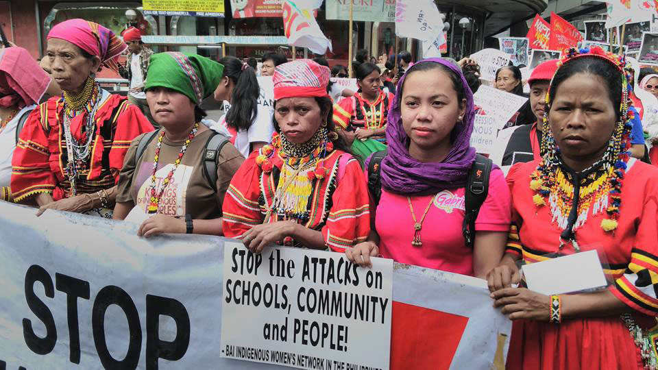 Bai Ali Indayla (second from right) joins Lumad women in a protest against human rights abuses. (By Kharlo Felipe Manano)