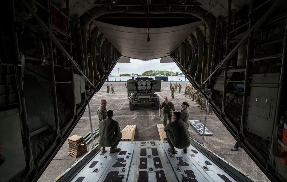 U.S. Marine KC-130J Super Hercules crew with Marine Aerial Refueler Transport Squadron 152, Marine Aircraft Group 12, 1st Marine Aircraft Wing, assist in loading a M142 High Mobility Artillery Rocket Systems during Balikatan 16 at Clark Air Base, Philippines, April 6, 2016. (U.S. Air Force photo by Tech. Sgt. Araceli Alarcon/From the Exercise Balikatan Facebook account)