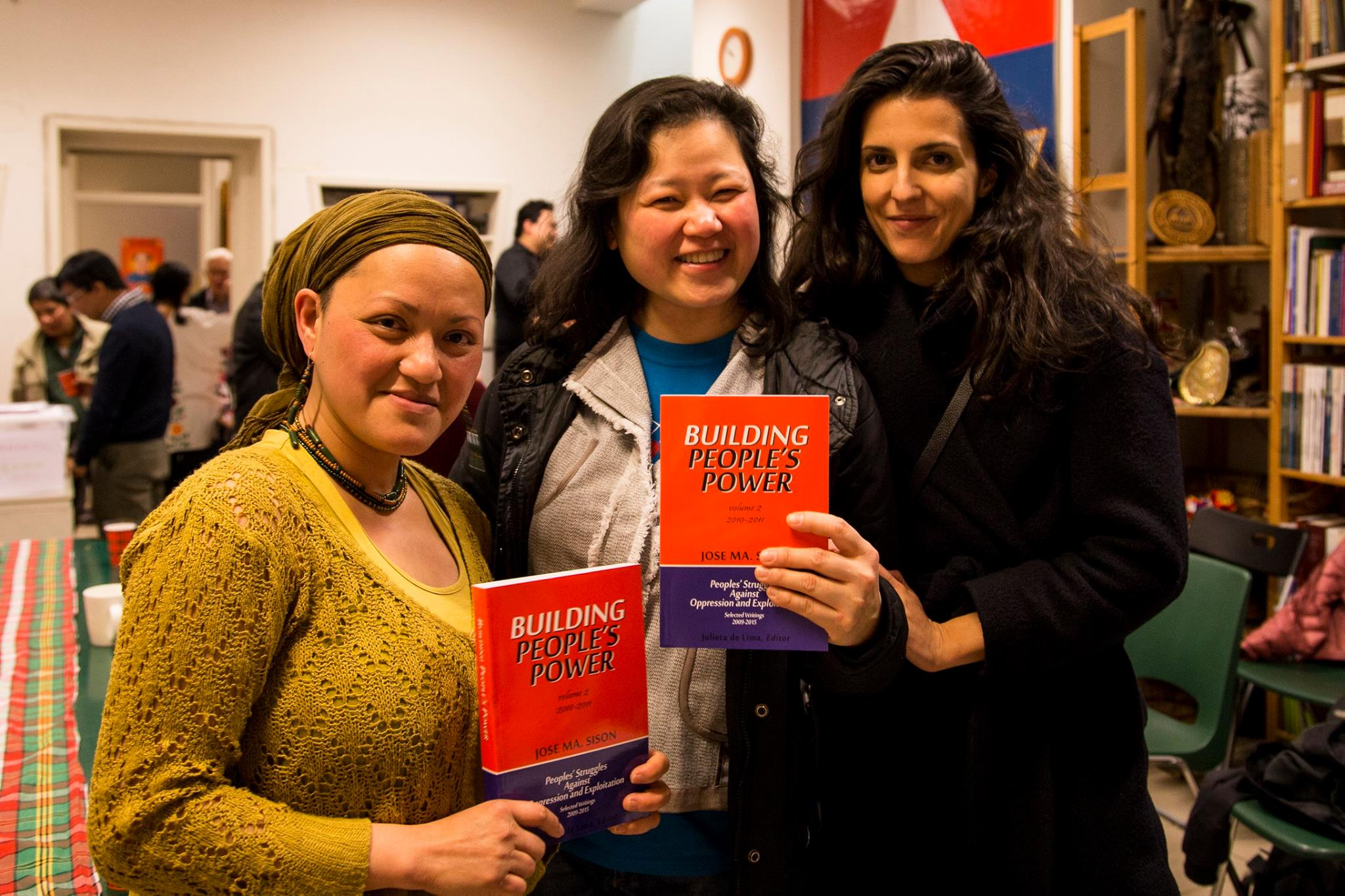 Joe Lampasa, Dr. Angie Gonzales and Paloma Polo hold a copy of the book