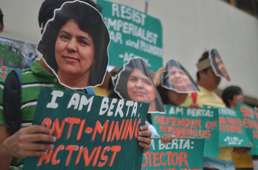 Filipino activists wear images of slain Honduran acivist Berta Cáceres at the picket in front of the Honduran consulate (Photo by Carlo Manalansan/Bulatlat.com)