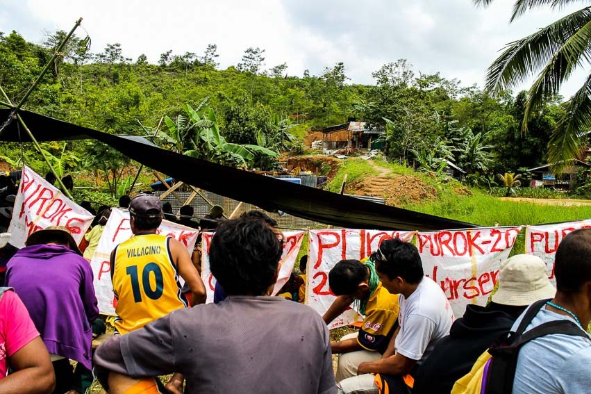 Compostela residents barricade the entrance to the Agpet mining exploration site in June 2015 (File photo by Ace Morandante/Davao Today)