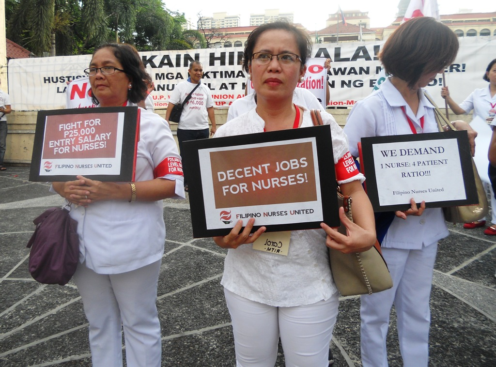 Nurses from different regions marching towards Phlippine General Hospital calling for more decent jobs for nurses and living wages. (Photo by A. Umil/ Bulatlat)