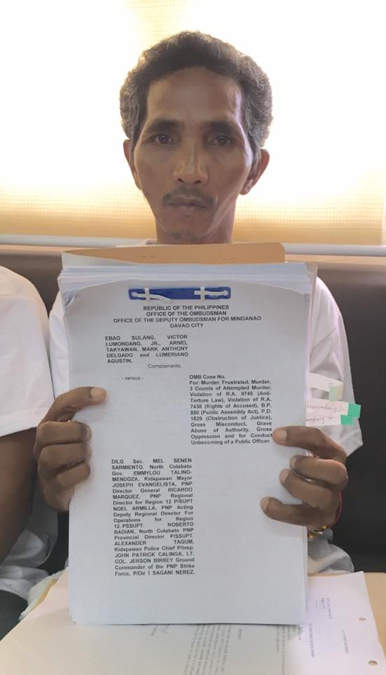 Ebao Sulang, father of slain farmer Darwin, leads filing of charges against local and national government officials. (Photo courtesy of Cristina Palabay)