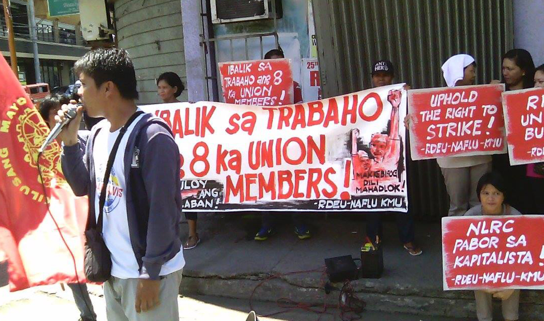 Members of Kilusang Mayo Uno – Southern Mindanao hold a protest action, May 30, at the RMN Anda Station to condemn the termination of RMN Davao union officers. (Contributed photo)