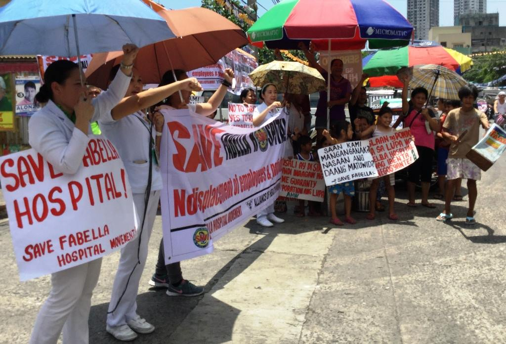 Members of the Alliance of Health Workers (AHW), Gabriela, employees, patients and members of the community held a picket in front of Fabella Hospital on May 3 to protest. (Photo by A. Umil.Bulatlat)