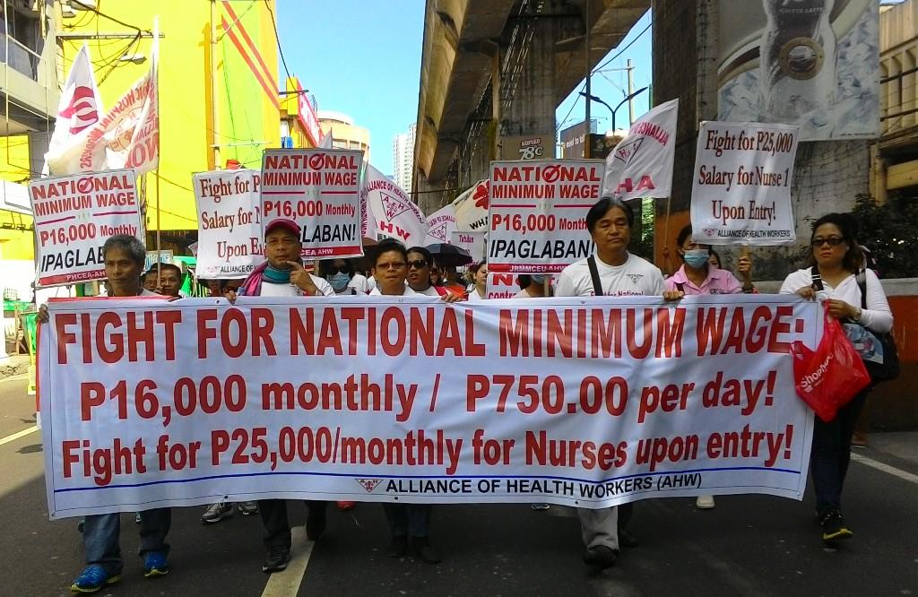 Hundreds of health workers marching towards Mendiola  to once again amplify their long-time demand: P16,000 ($340) monthly minimum wage for government workers and P750 ($16) monthly increase for private employees.  (Photo by A. Umil/ Bulatlat)