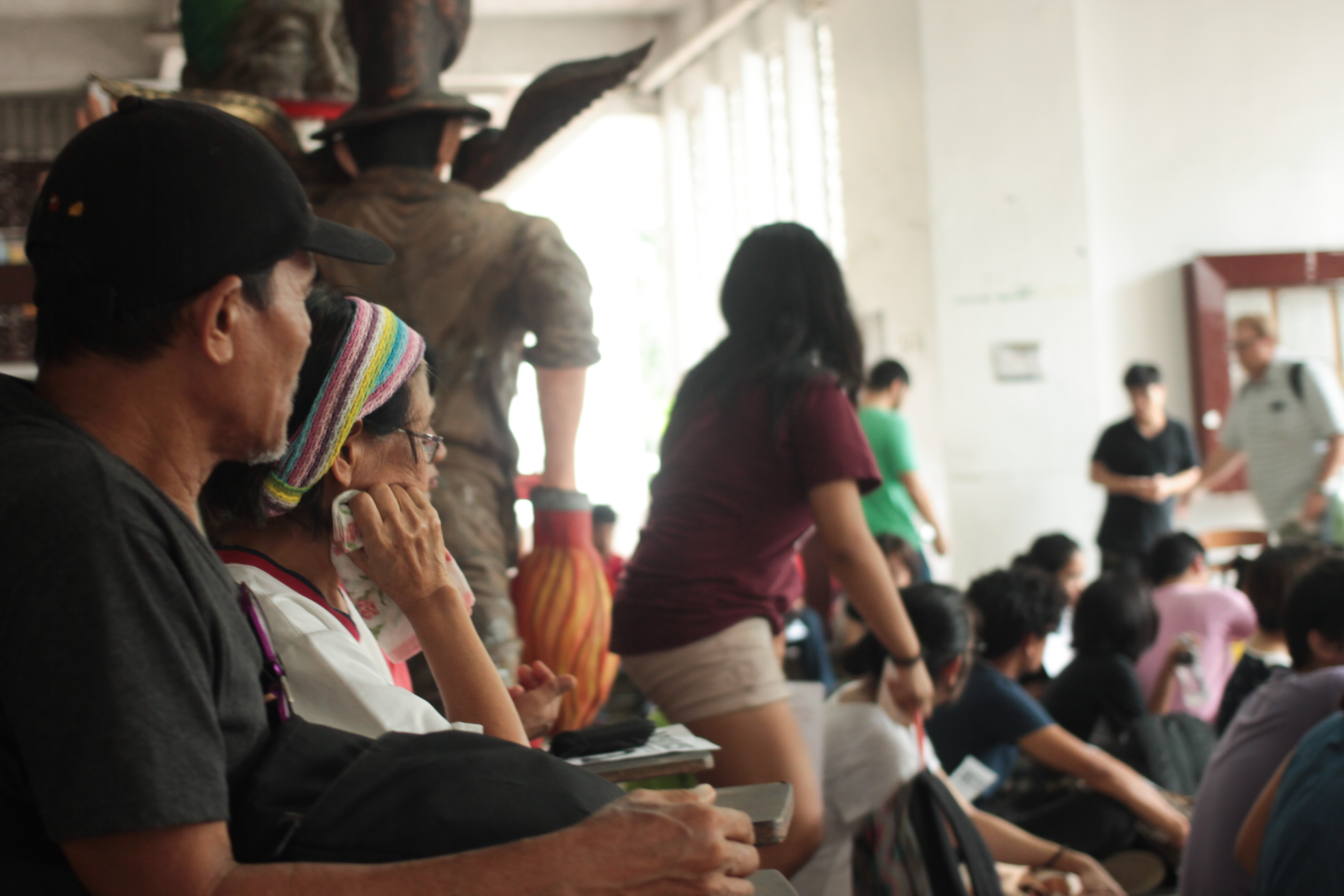 Asher and Linda Cadapan (foreground) look on during the program at Palma Hall lobby (Photo by G.Estella/Bulatlat)