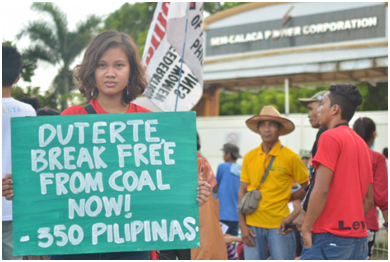 350 Pilipinas activist Zeph Repollo  during anti-coal protest action in front Sem Calaca Power Corporation in Batangas province. (Photo by Kalikasan PNE)