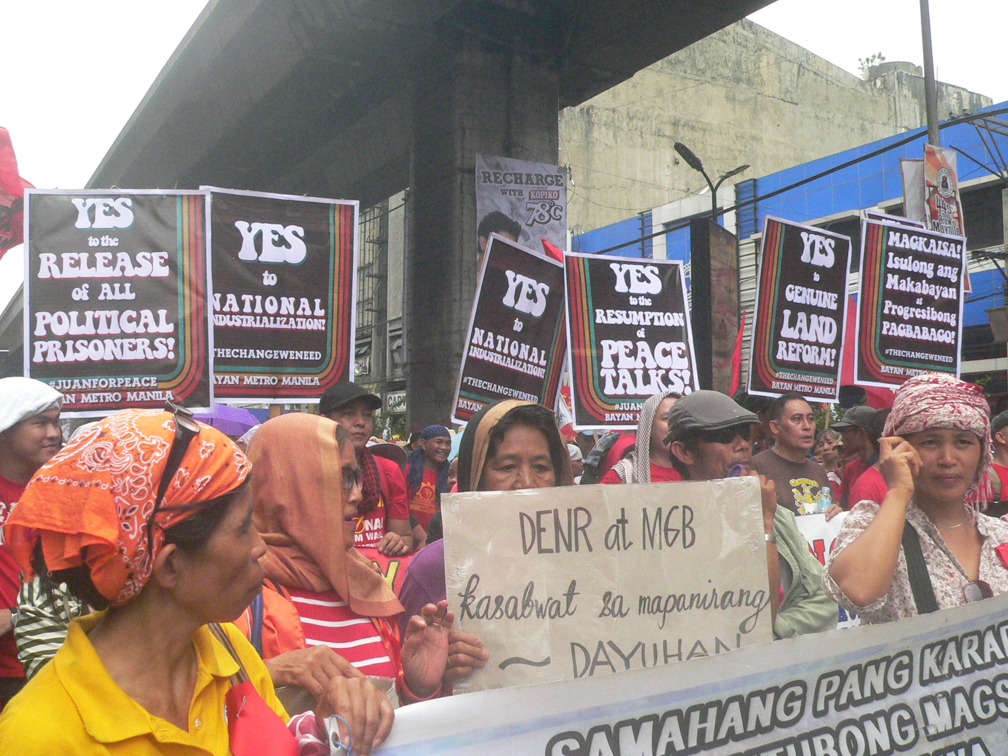 Members of Sapakmmi from Didipio, Kasibu, Nueva Vizcaya join the Mendiola rally on June 30 to call for a stop of OceanaGold's mining. (Photo by Dee Ayroso/Bulatlat)