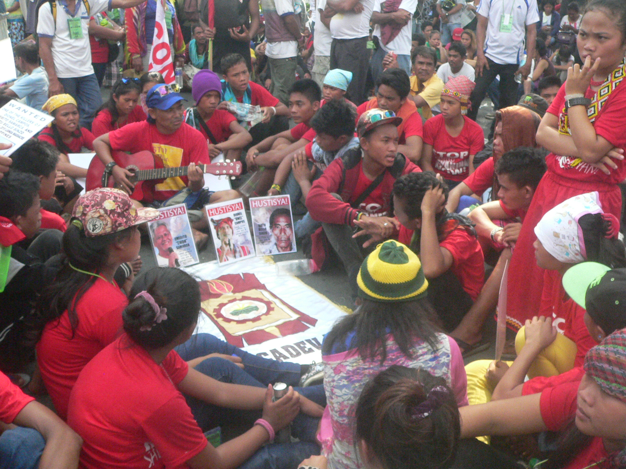 Alcadev students gathered around a Lumad leader outside the Batasang Pambansa on July 25, 2016. (Photo by Dee Ayroso/Bulatlat)