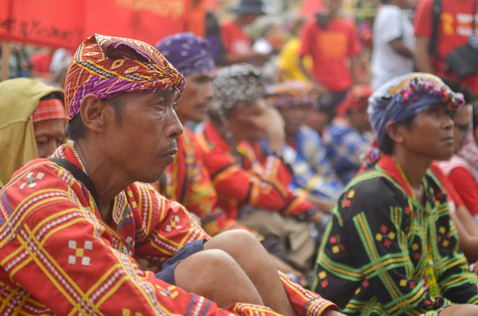 BULATLAT FILE PHOTO: Lumad rallyists sat outside the Batasang Pambansa, listening to President Duterte's first SONA. (Photo by Carlo Manalansan/Bulatlat)