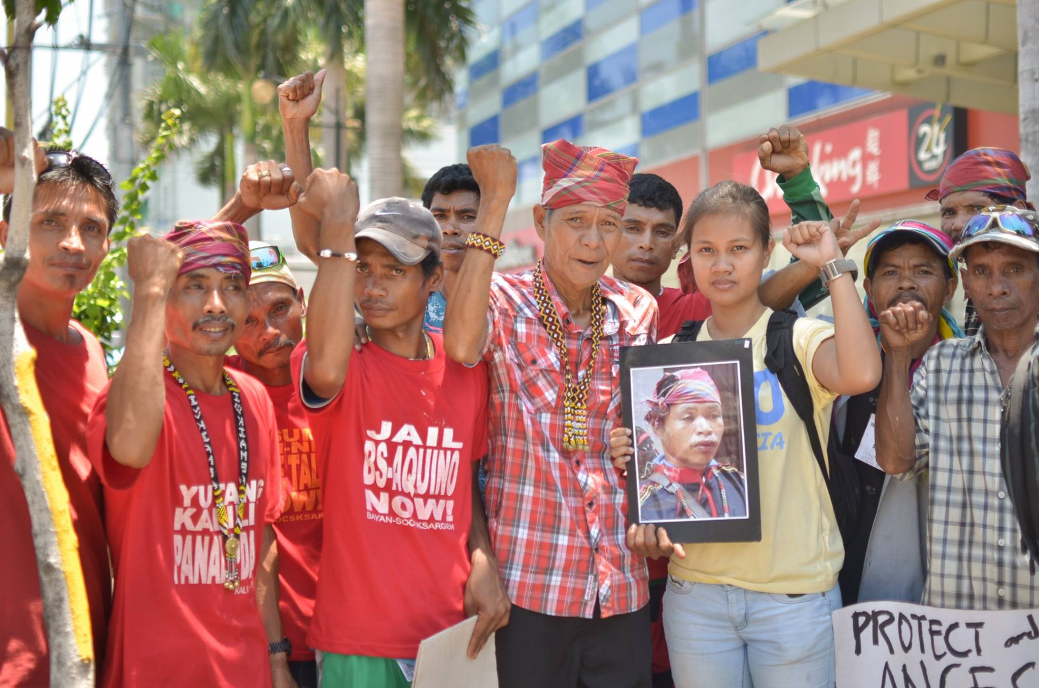 The author, together with Dulangan Manobos who travelled to DMCI's headquarters in Metro Manila to join the protest of various communities affected by DMCI extractive projects. By Loi Manalansan/Kalikasan PNE