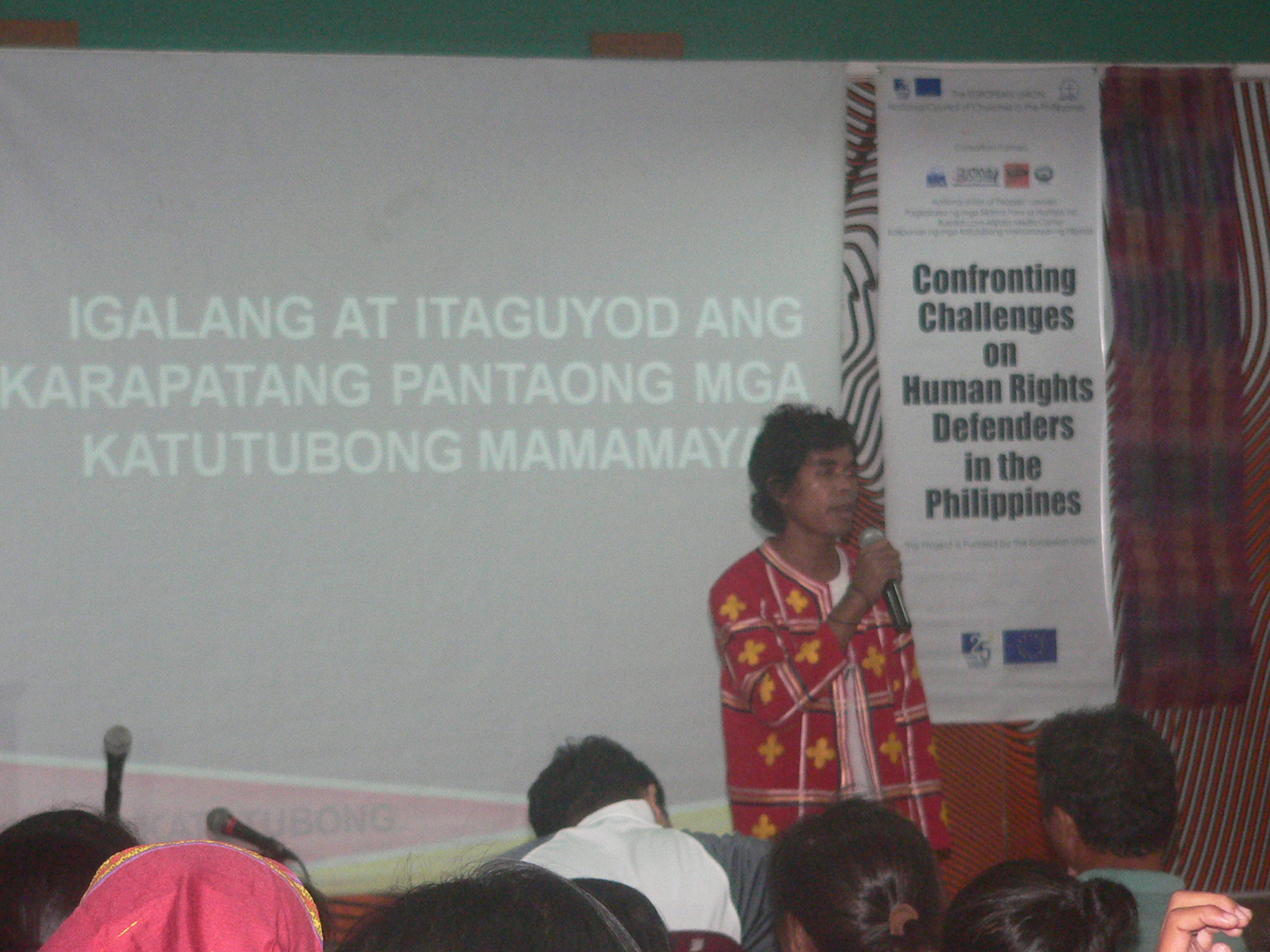 "Datu Jimboy Mandagit spoke at the forum ""Land, rights, justice"" at the College of Holy Spirit on Aug.8 (Photo by Dee Ayroso/Bulatlat)"