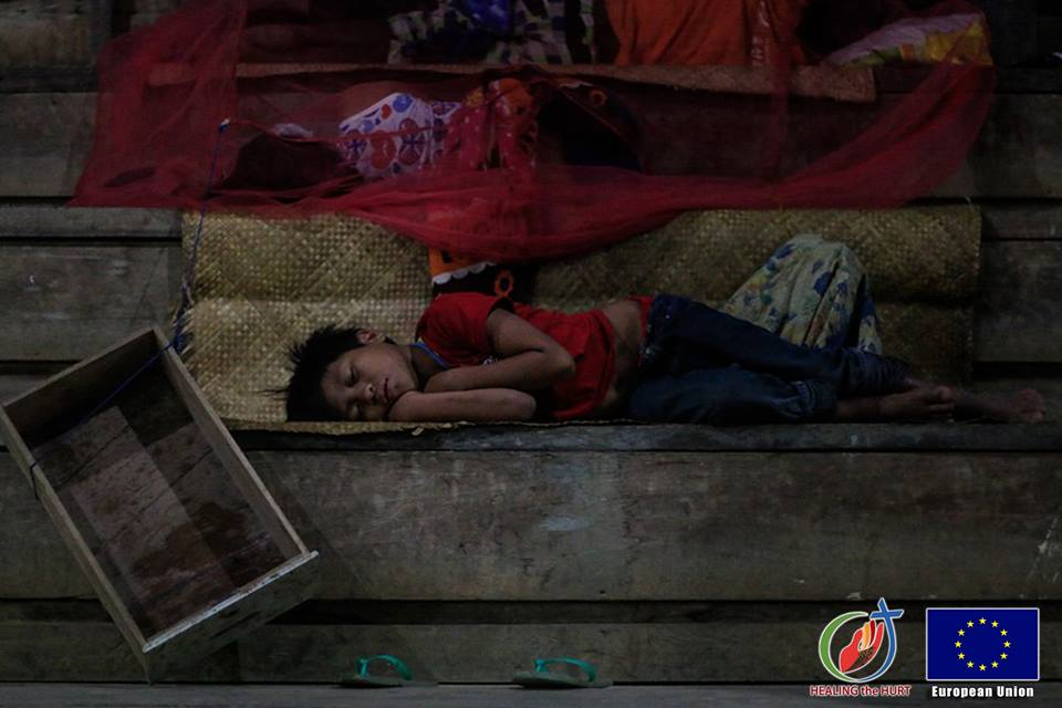 Manobo children sleep at the public gym in Zillovia village proper, Talacogon, Agusan del sur where they evacuated on July 4. (Photo courtesy of Healing the Hurt Project)