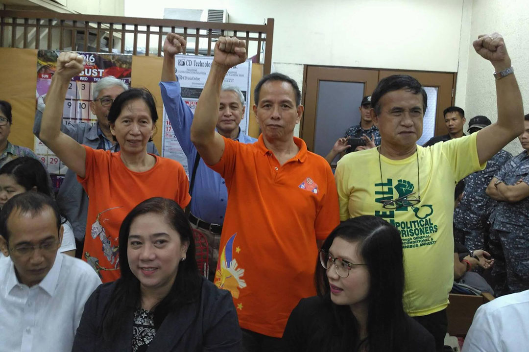 BULATLAT FILE PHOTO. (Standing) NDFP consultants accused in connection with the alleged mass graves in Inopacan, Leyte.