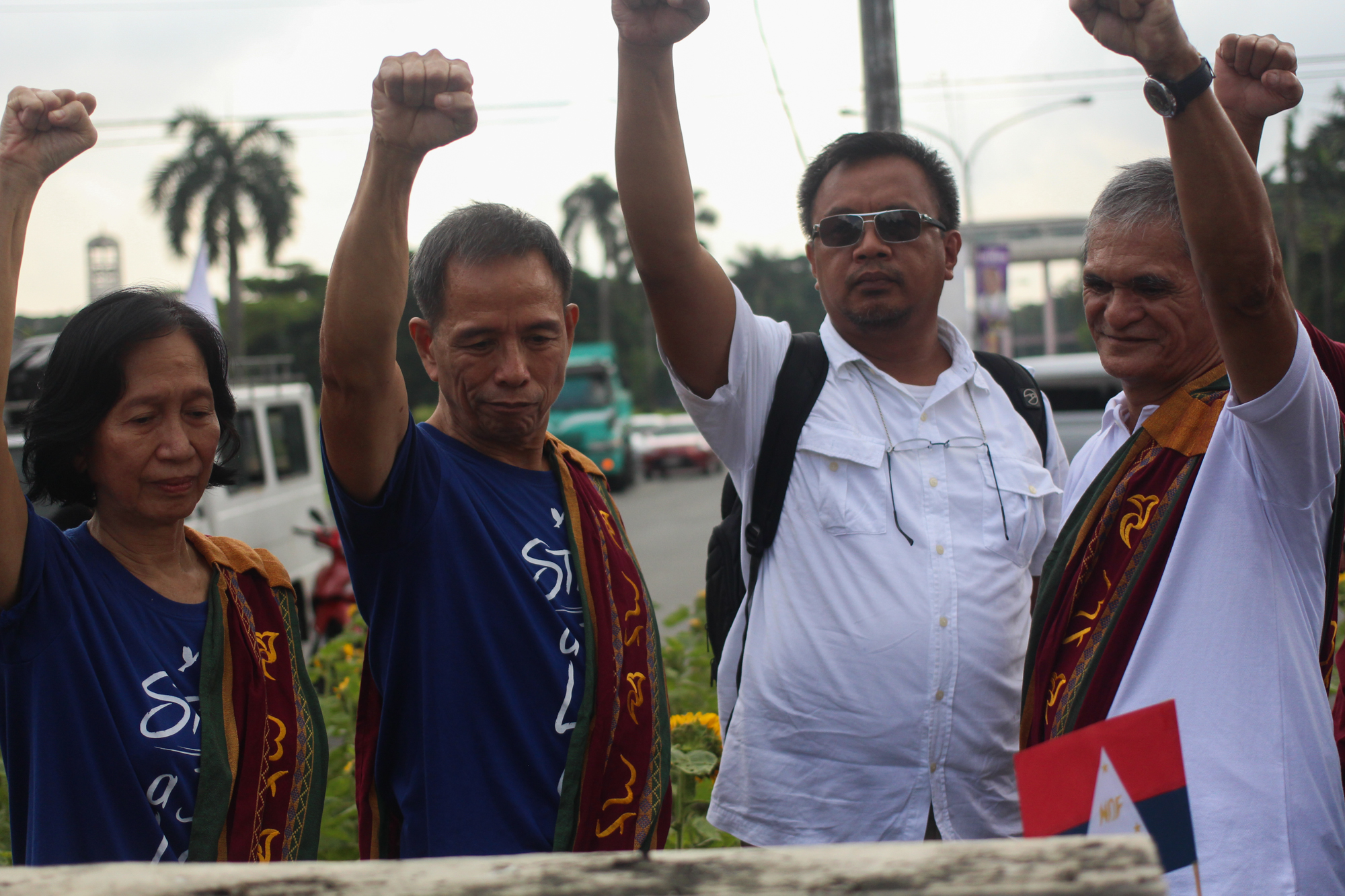 L-R: NDFP peace consultants Wilma Austria-Tiamzon, Benito Tiamzon, Randy Malayao, and Jaime Soledad in front of the Diliman Commune marker along University Avenue (Photo by Gino Estella/Bulatlat)