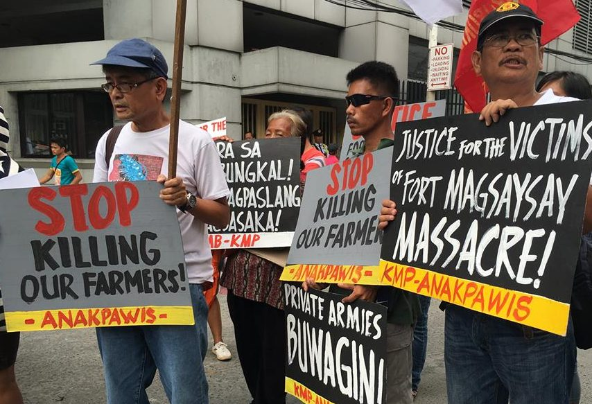 Peasant leaders Danilo Ramos of UMA (left) and Joseph Canlas of KMP (rightmost) join the indignation protest outside the Department of Interior and Local Government over the killing of four farmers in Nueva Ecija (Contributed photo)