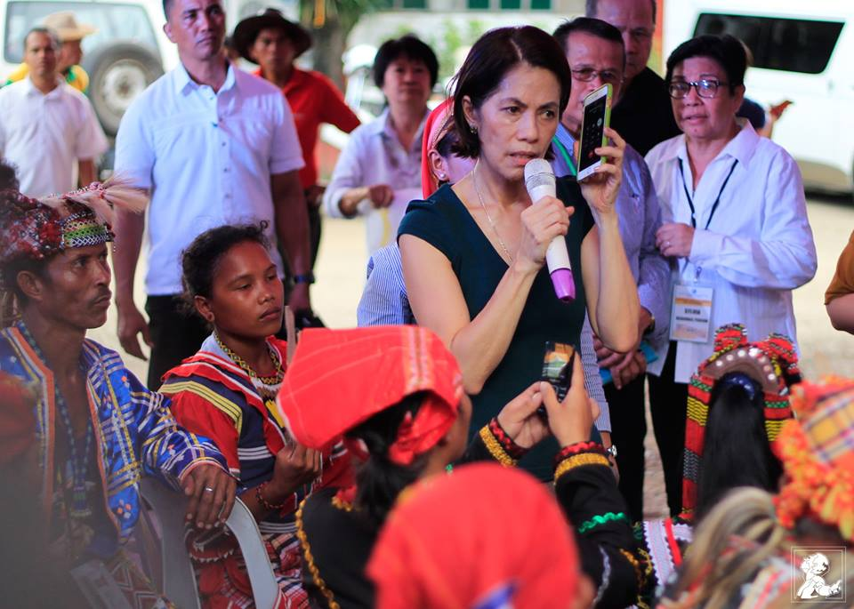 Environment Secretary Gina Lopez puts AFP Chief Lt. Gen. Ricardo Bisaya on speaker phone, in a dialogue with indigenous peoples. (Photo by Chester Higuit/Philippine Collegian)