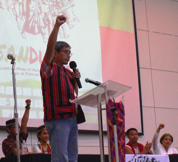 BULATLAT FILE PHOTO: Kennedy Bangibang, peace consultant of the National Democratic Front of the Philippines (NDFP), joins fellow national minorities at the Sandugo assembly on Oct. 14, and asks them to remain vigilant and continue asserting their rights. (Photo by Ronalyn V. Olea / Bulatlat)