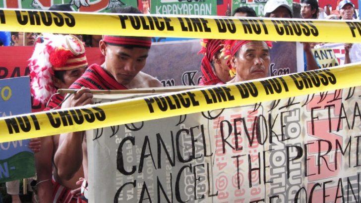National minorities put crime scene yellow tape on mining firms' gates