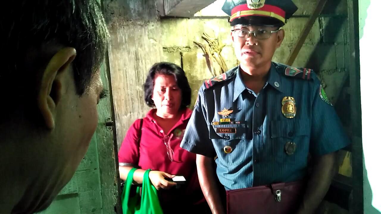 A police man visited Raymark Sumalbag at his home (Photo by JR Burgos/Pinoy Weekly)