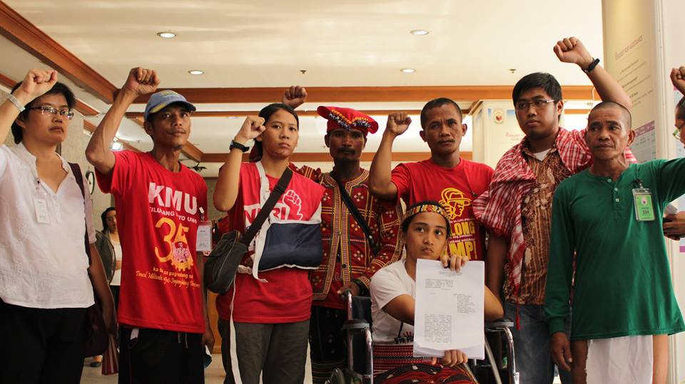 UNBOWED. (L-R) Dr. Julie Caguiat, Reyan Naong, Nicole Soria, a Manobo datu, Dionesio Abear, Jerome Aba, Reynaldo Moldon, and Piya Macliing Malayao (in wheelchair) at the Ombudsman on Oct. 26. The activists charged the Manila Police with attempted murder and other criminal and administrative cases. (Contributed photo)