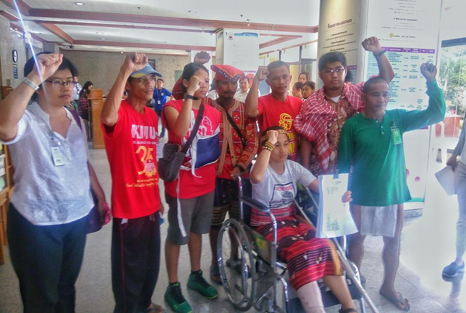 'NOW WE MAKE THEM PAY.' (L-R) Dr. Julie Caguiat, Reyan Naong, Nicole Soria, a Manobo datu, Dionesio Abear, Jerome Aba, Reynaldo Moldon, and Piya Macliing Malayao (in wheelchair). Except for Aba and the Manobo datu, the six are among the nine activists who charged the Manila Police with attempted murder and other criminal and administrative cases at the Ombudsman, Oct. 26. (Photo by Kilab Multimedia)