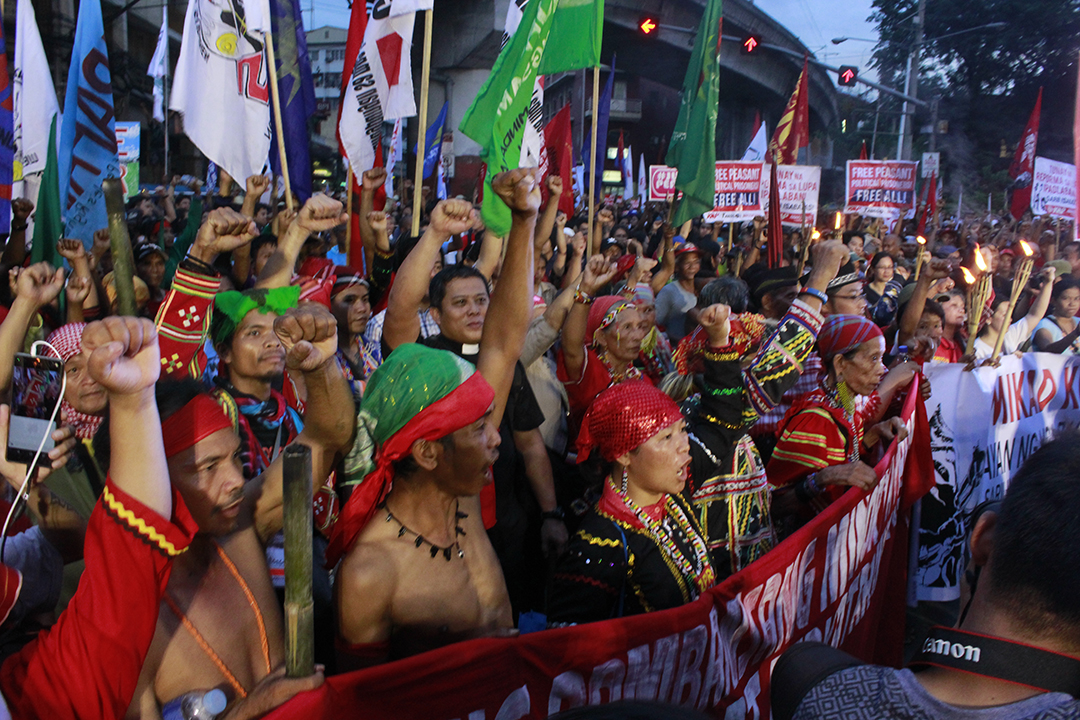 National minorities cry out for self determination in the streets of Manila, Philippines. (Photo by Ken Bautista/IPMSDL)